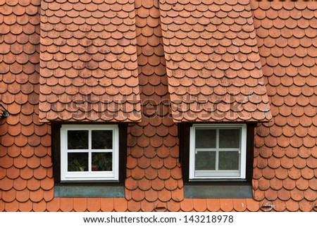 red clay roof with two windows background - stock photo