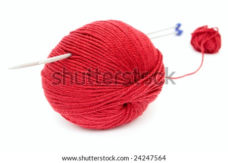 red clew with knitting needles over white