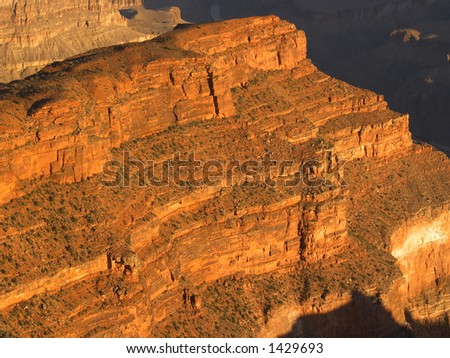 Red cliff at sunrise in Grand Canyon, seen from Hopi Point