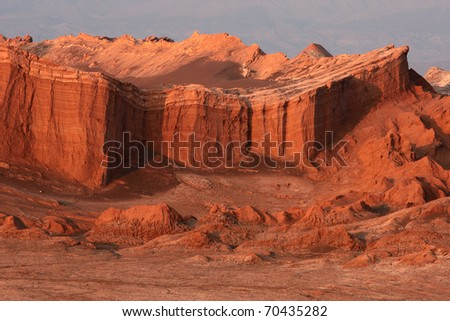 Red cliffs of Moon Valley in Chile at sunrise - stock photo