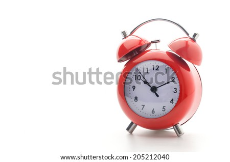 Red clock isolated on white - stock photo