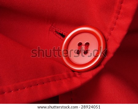 red clothes fragment with button