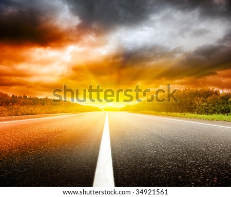 red clouds and road - stock photo
