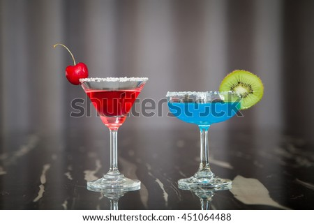 Red cocktail and blue cocktail.