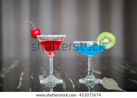 Red cocktail and blue cocktail. - stock photo