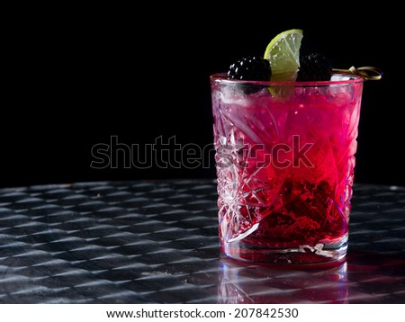 Red cocktail in a whisky glass - stock photo