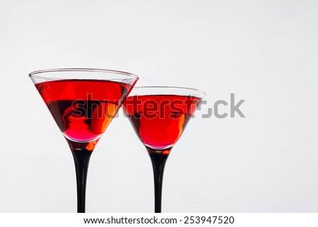 Red cocktail in martini glasses - stock photo