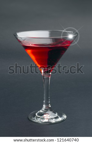red cocktail isolated on black background - stock photo