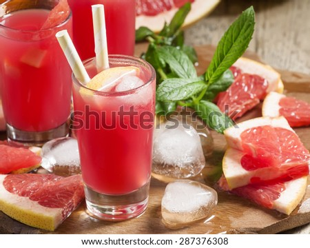 Red cocktail of fresh pink grapefruit, selective focus - stock photo