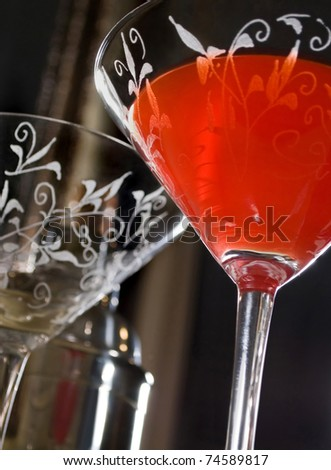 red cocktail on bar in an elegant lounge - stock photo