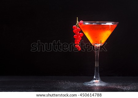 red cocktail on dark background - stock photo