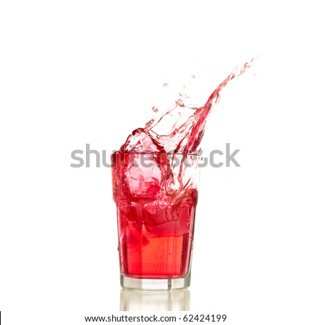 Red cocktail splashing on a glass on white background - stock photo