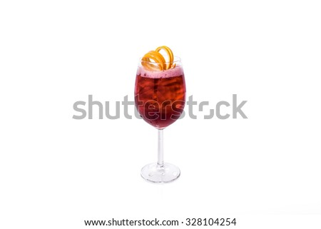 Red Cocktail with orange garnish - stock photo