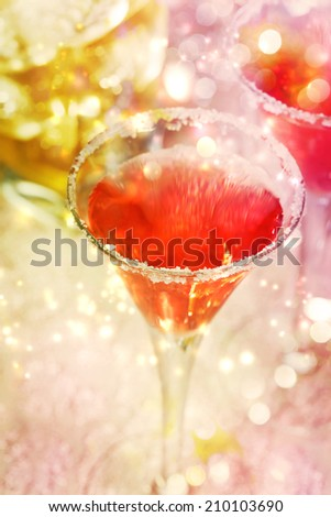 Red cocktail with salt over shiny lights - stock photo