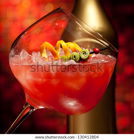 Red Cocktail with Vodka, Orange Juice, Berries and Liquor - stock photo
