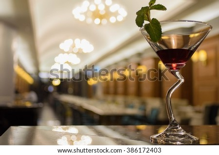 Red Cocktails on the bar counter and Blurred background,restaurant