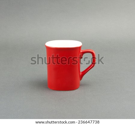 red coffee cup on a gray background - stock photo