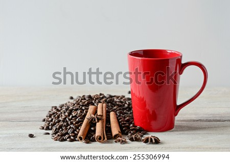 Red coffee cup on wooden table - stock photo