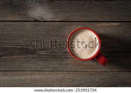 Red Coffee cup on wooden table. View from top  - stock photo