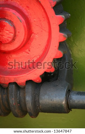 red cog and worm - stock photo