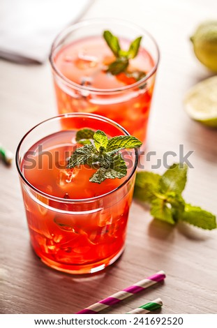 Red cold summer cocktail drink with mint - stock photo