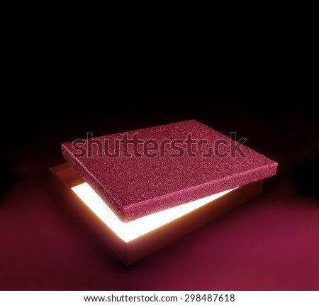 Red color gift box. Opened box against black background with copy space. Light effect inside. Clipping path on the box and inside box - stock photo