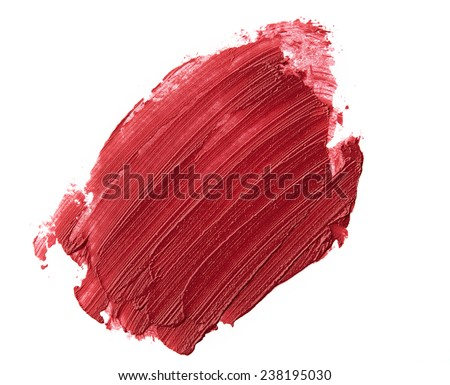 Red color lipstick stroke on white paper - stock photo