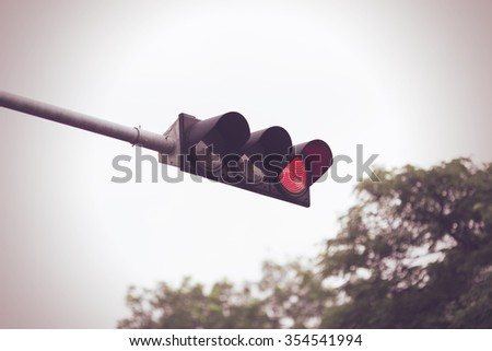 Red color on the traffic light. selective focus. Vintage style. - stock photo