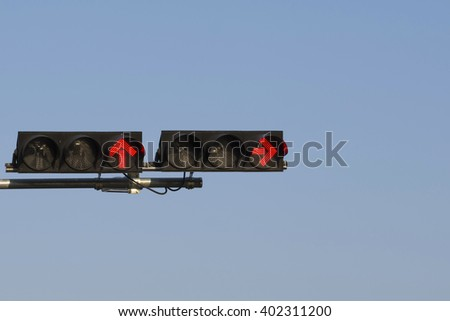 Red color on the traffic light with blue sky in background - stock photo