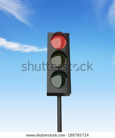 red color on traffic light with a beautiful blue sky in background