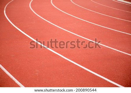 red color running track in football stadium