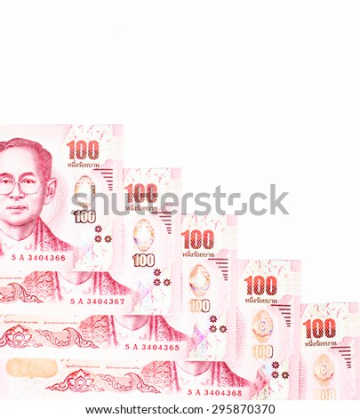 Red color with one hundred banknotes of Thai currency on white background - stock photo
