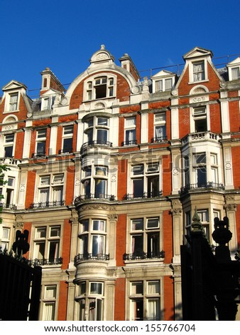 Red colored house  in  center of London - stock photo