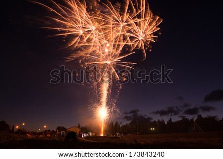 Red colorful fireworks on blue sky background