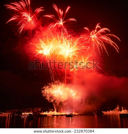 Red colorful fireworks on the black sky background - stock photo