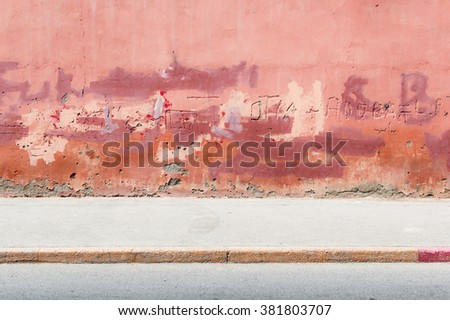 Red colorful wall, street scene