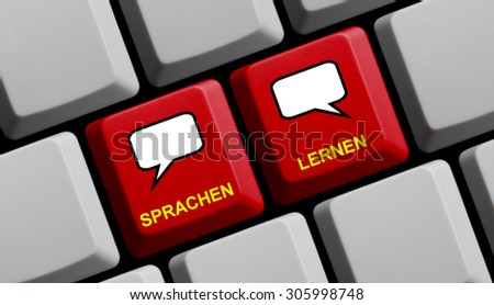 Red Computer keyboard with two speech bubble showing learning languages - stock photo