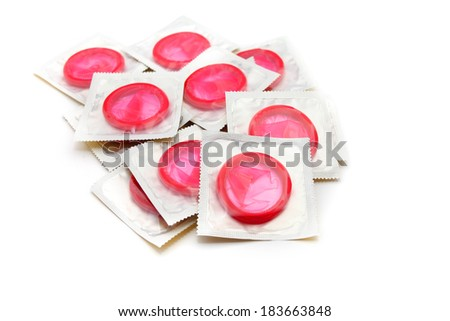 Red condoms isolated on white  - stock photo