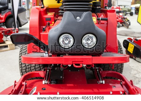 Red construction machine detail - front lights and levers.