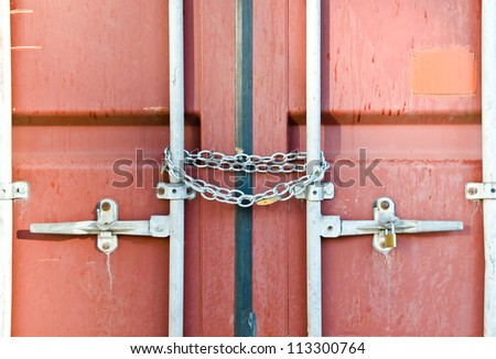Red container locked by chain - stock photo