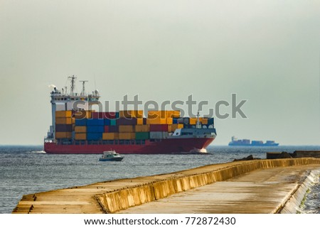 Red container ship. Logistics and production transfer