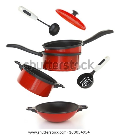 Red cookware set on white background - stock photo