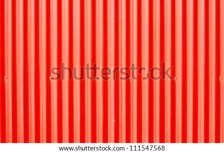 Red corrugated metal as a background image - stock photo