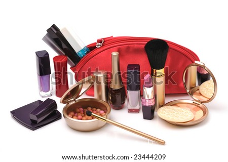 red cosmetic bag  with a lot of cosmetics on white