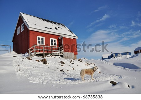 Red cottage in the Kulusuk village, Greenland - stock photo