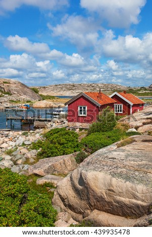 Red cottages by the bay on the Swedish west coast - stock photo