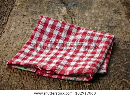 red cotton napkin on old wooden table