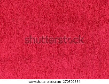 Red cotton towel texture. Background and textures. - stock photo