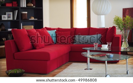 red couch in modern living room - stock photo