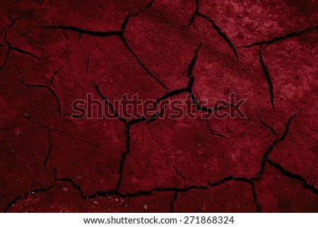 red cracked and barren ground - stock photo
